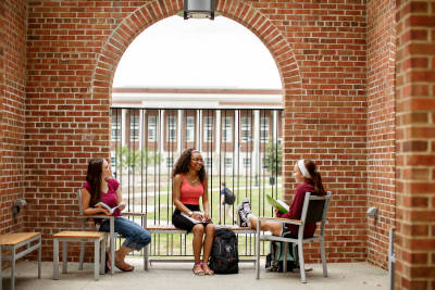 students sitting at a table on EKU campus